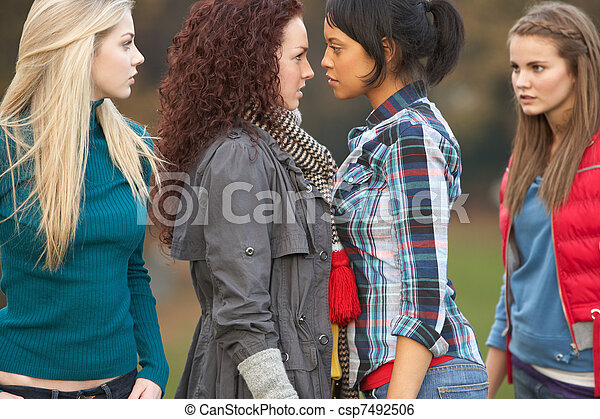 Group Of Confrontational Teenager Girls - csp7492506