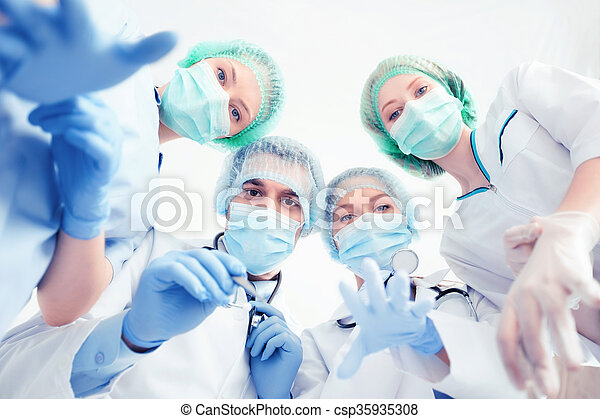 group of doctors in operating room - csp35935308