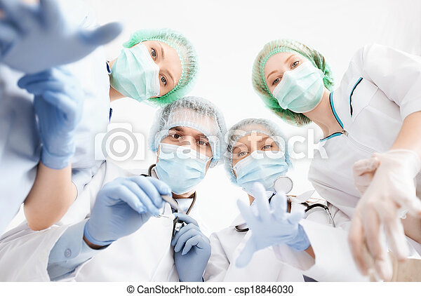 group of doctors in operating room - csp18846030