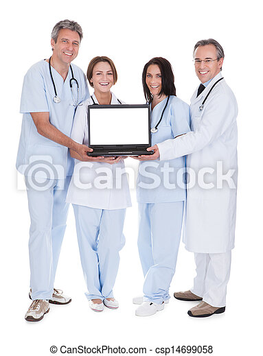 Group Of Doctors With A Laptop - csp14699058