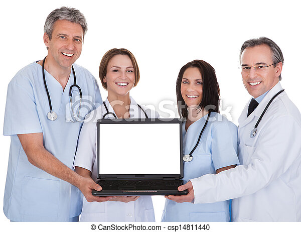 Group Of Doctors With A Laptop - csp14811440