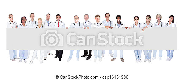 Group Of Doctors With Placard - csp16151386