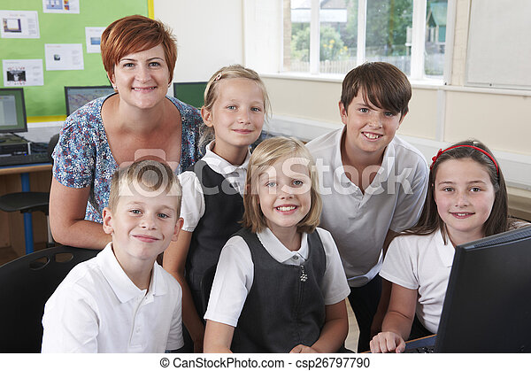 Group Of Elementary Pupils In Computer Class With Teacher - csp26797790