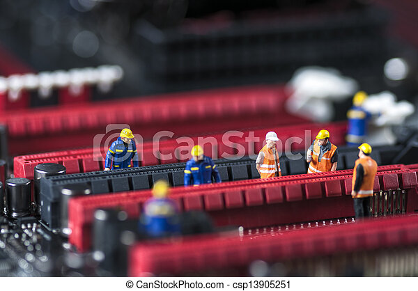 Group of Engineers Fixing Computer Circuit Board - csp13905251