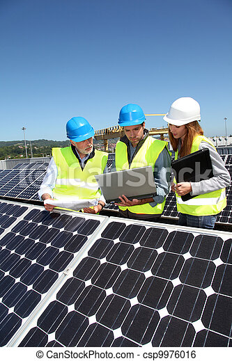 Group of engineers meeting on building roof - csp9976016