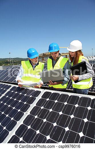 Group of engineers meeting on building roof - csp9976016