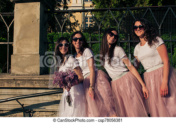 Group of female friends celebrate bachelorette party - csp78056381