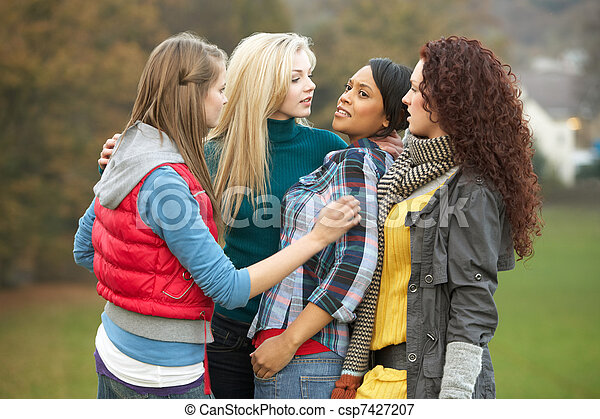 Group Of Female Teenagers Bullying Girl - csp7427207