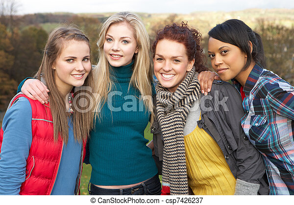Group Of Four Teenage Female Friends In Autumn Landscape - csp7426237