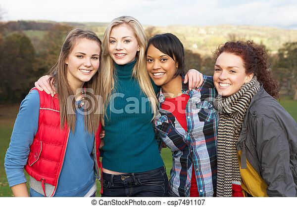 Group Of Four Teenage Female Friends In Autumn Landscape - csp7491107