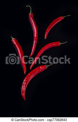 Group of fresh spicy chili peppers. - csp77062643