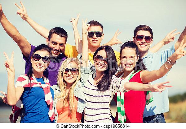group of friends having fun on the beach - csp19658814