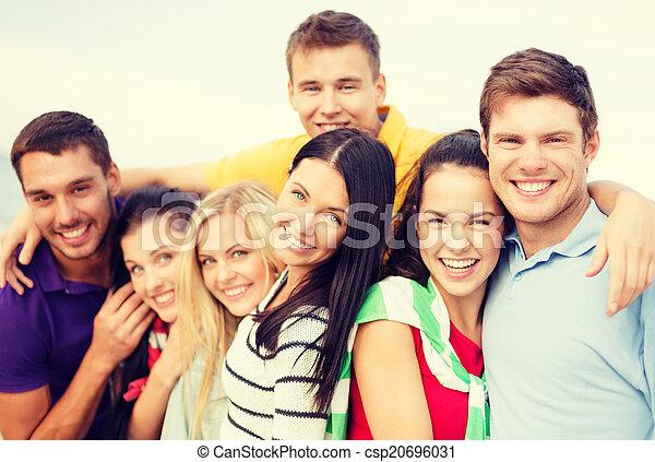 group of friends having fun on the beach - csp20696031