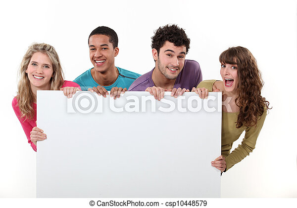 group of friends holding a blank poster - csp10448579