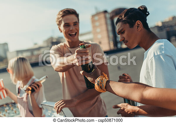 group of friends sharing beer - csp50871000