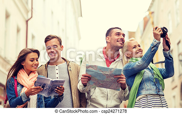 group of friends with city guide, map and camera - csp24271278