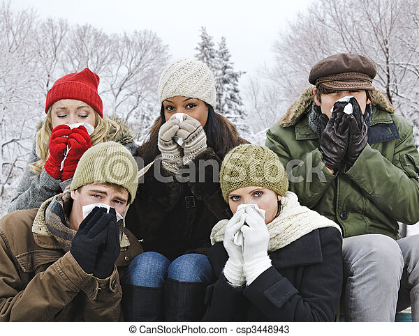 Group of friends with colds outside in winter - csp3448943