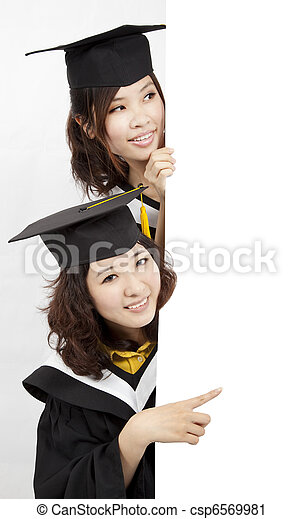 Group of  graduates holding a blank banner - csp6569981