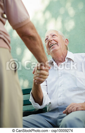 Group of happy elderly men laughing and talking - csp10009274