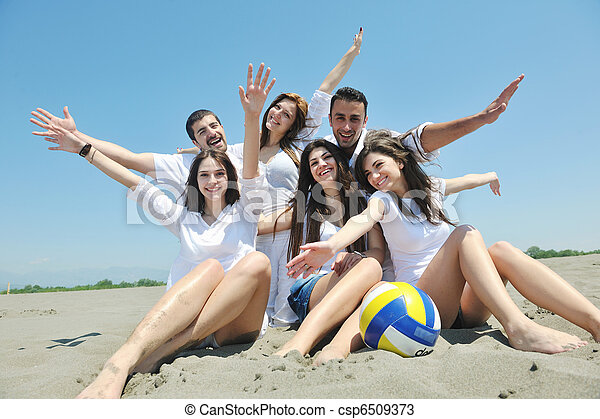 Group of happy young people in have fun at beach - csp6509373