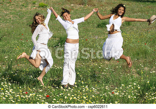 group of happy young women jumping on summer or spring - csp6022611