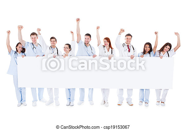 Group of healthcare personnel holding a banner - csp19153067