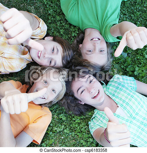 group of kids with thumbs up - csp6183358