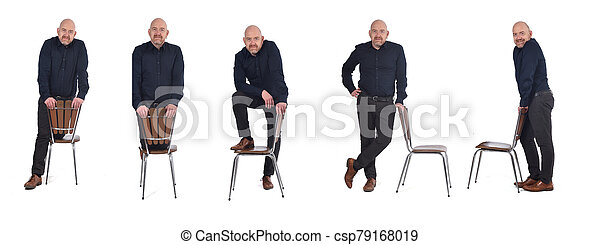 group of man standing with a chair in white background - csp79168019