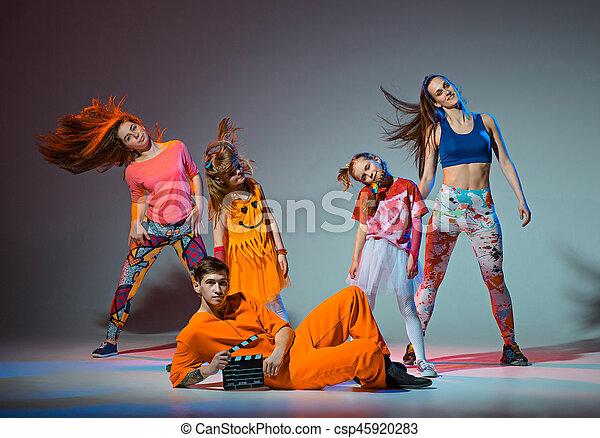 Group of man, woman and teens dancing hip hop choreography ...