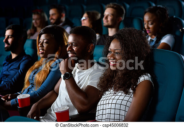 Group of multicultural friends at the movie theatre - csp45006832