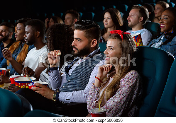 Group of multicultural friends at the movie theatre - csp45006836