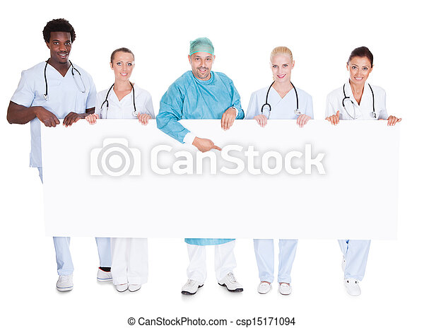 Group Of Multiracial Doctors Holding Placard - csp15171094