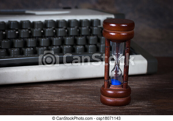 Group of objects on wood table. hourglass,  type writer ,Still life - csp18071143