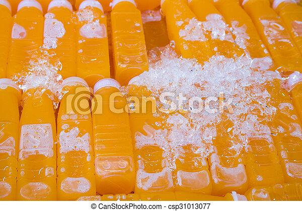 group of orange juice bottle with ice - csp31013077