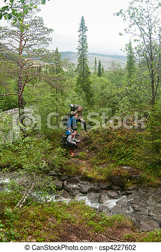 Group of people climbing and trakking in hills - csp4227602