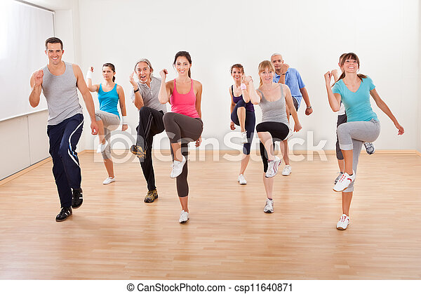 Group of people doing aerobics exercises - csp11640871