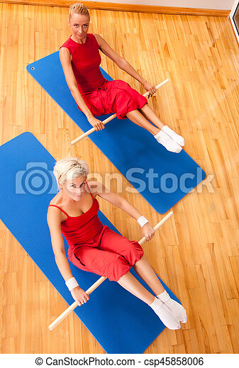 Group of people doing fitness exercise - csp45858006