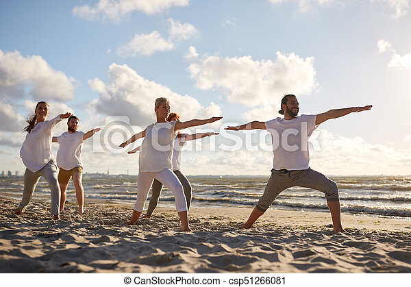 group of people making yoga exercises on beach - csp51266081