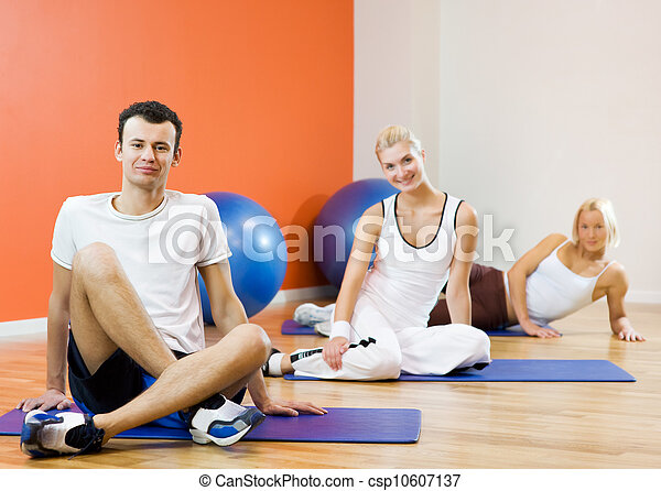 Group of people relaxing after fitness exercise - csp10607137
