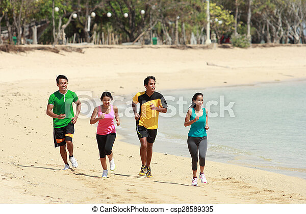 group of people running on beach, Sport concept - csp28589335