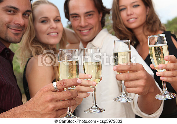 group of people toasting with champagne at party - csp5973883