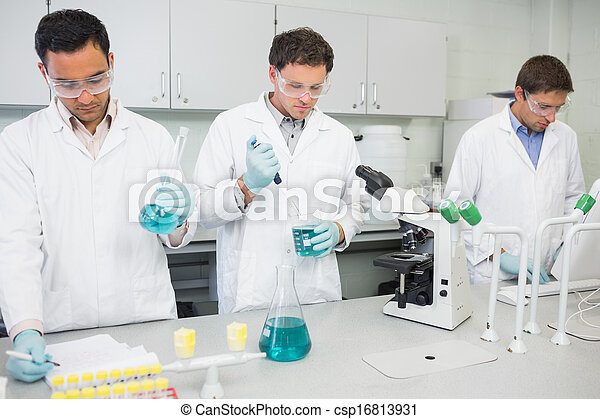 Group of scientists working at the lab - csp16813931