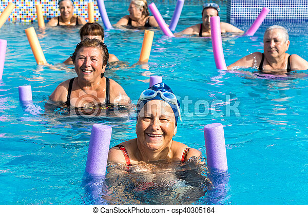 Group of senior women at aqua gym session. - csp40305164