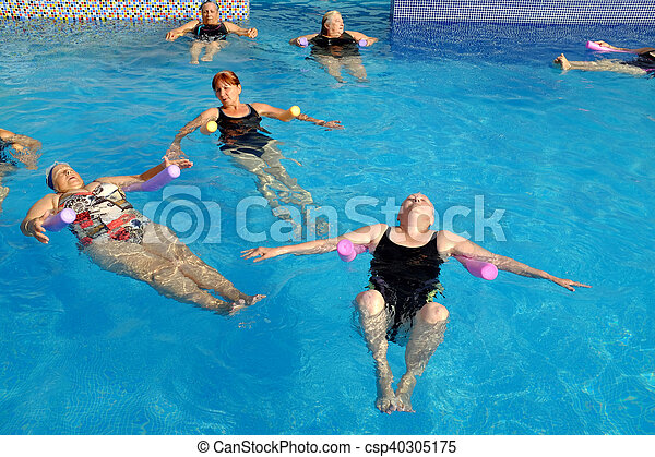 Group of senior women doing exercise in pool. - csp40305175
