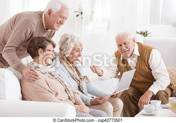 Group of seniors with laptop - csp42773501