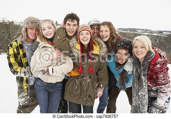 Group Of Teenage Friends Having Fun In Snowy Landscape - csp7426757