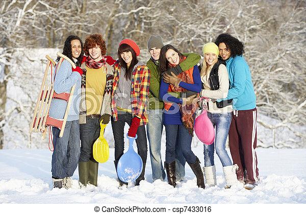 Group Of Teenage Friends Having Fun In Snowy Landscape - csp7433016