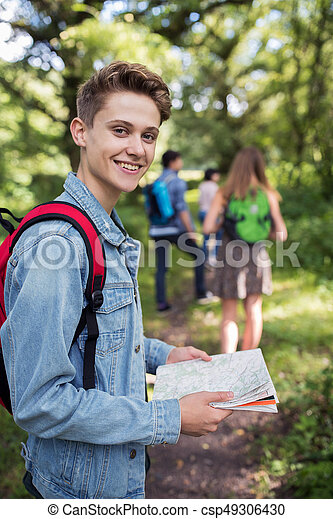 Group Of Teenage Friends Hiking In Countryside Together - csp49306430