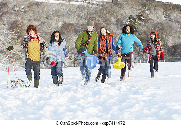 Group Of Teenage Friends Sledging In Snowy Landscape - csp7411972