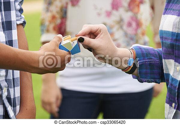 Group Of Teenagers Smoking - csp33065420